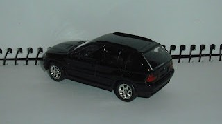 BMW X5 de 2005 , escala 1/60 de Welly .
