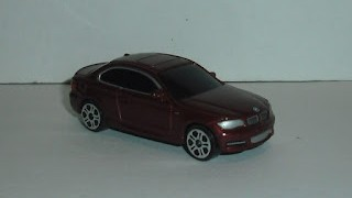 BMW Series 1 Coupe , escala 1/64 , Color Granate de Maisto .