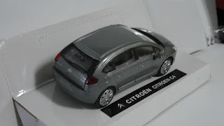 Citroen C4 , escala 1/43 , Color Plata , de la marca  New Ray ..